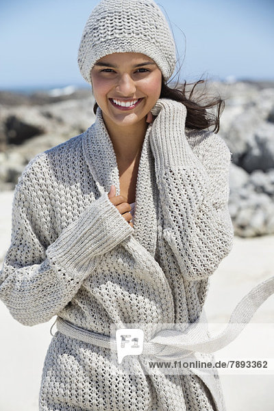 Beautiful woman enjoying on the beach in winter
