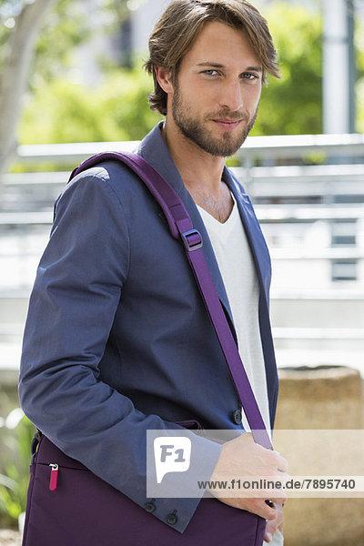 Portrait of a man with a shoulder bag