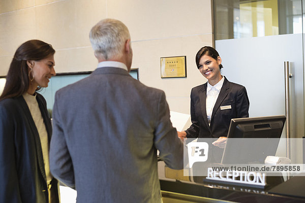 Business couple checking into hotel