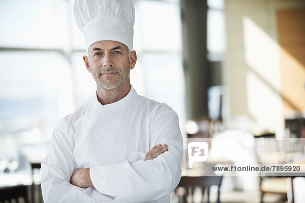 Portrait of a chef with arms crossed in a restaurant