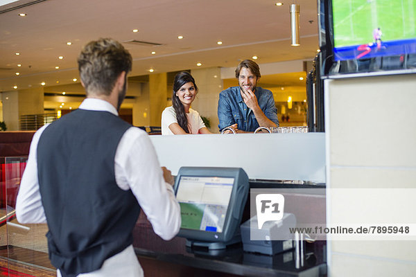 Couple at checkout counter in a restaurant