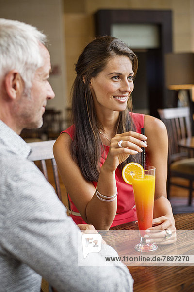 Couple enjoying drink in a restaurant