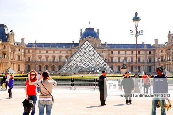 Looking at I.M. Pei's Pyramid Entrance to the Louvre  Paris  France  from the Carousel de Louvre.