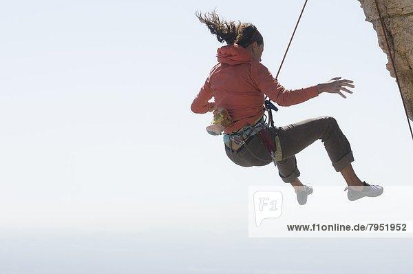 Felsbrocken  fallen  fallend  fällt  Frau  Wind  Arizona  Klettern  zeigen  Tucson