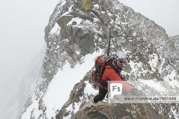 Mann  über  Wald  See  klettern  Colorado  Como