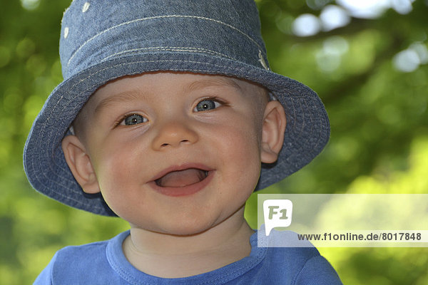 Smilng toddler with a hat  portrait