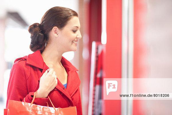 Young woman window shopping