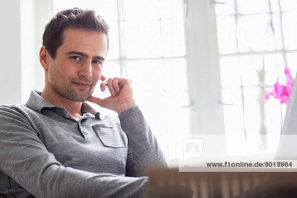 Mature man sitting relaxing  looking at camera