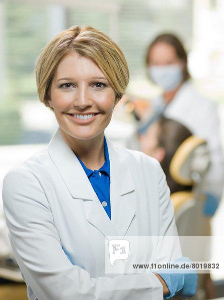 Mid adult dentist smiling  portrait