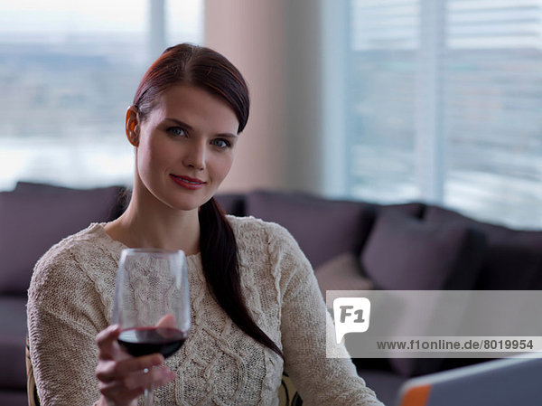 Young woman holding glass of wine  portrait