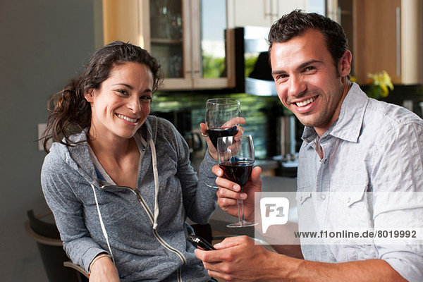 Young couple enjoying wine at home  portrait