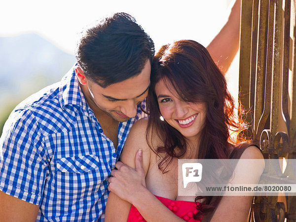 Young couple with woman smiling  portrait