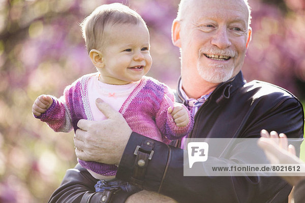 Close up portrait of baby girl and grandfather