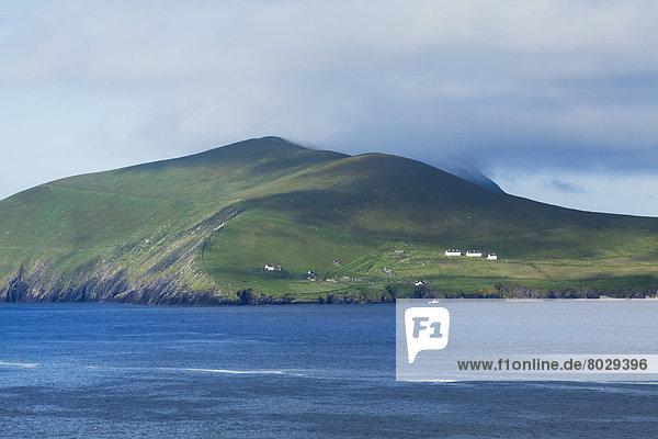 Houses on a hillside on the blasket islands on blasket sound County kerry ireland