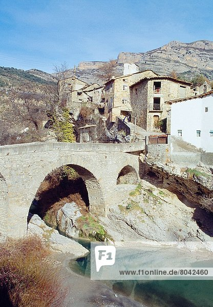 Medieval bridge and village. Serraduy  Huesca province  Aragon  Spain.