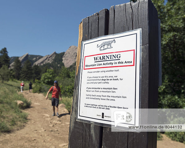 Mountain Lion warning sign in Chautauqua Park and mountain trail  Boulder  Colorado  USA