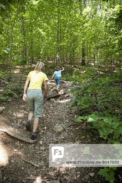 USA  New York State  Woman and child trekking in forest  Hudson Valley