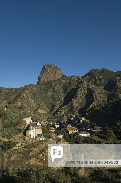View of Town with Roque Cano in background   Vallehermoso  La Gomera  Canary Islands  Spain