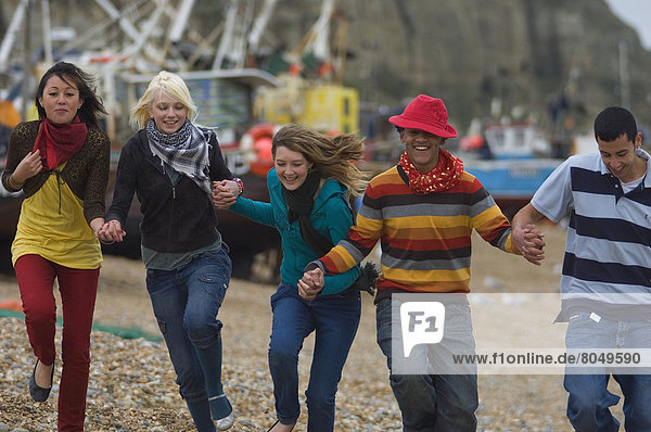 Mixed group of teenagers at seaside  Hastings  UK