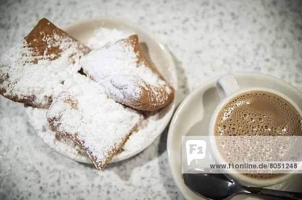 Vereinigte Staaten von Amerika USA Tasse Zucker Kaffee Eiscreme Eis Louisiana New Orleans Gebäck