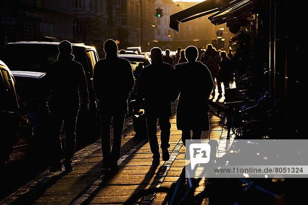 Pedestrian in late afternoon light  Copenhagen  Denmark