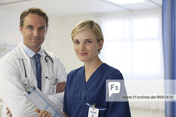 Doctor and nurse smiling in hospital