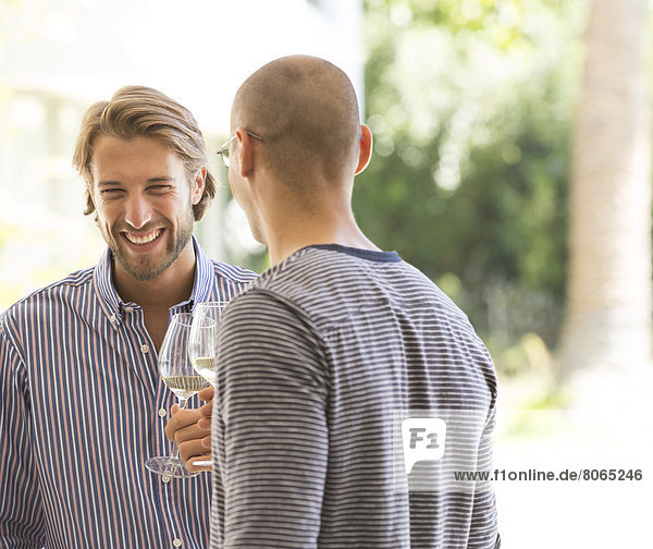 Men drinking wine together