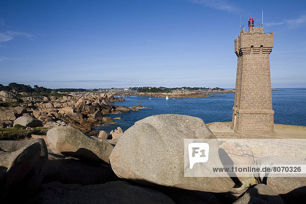'Cote de Granit rose (Pink Granite Coast) at Ploumanach (22) : Automatic Lighthouse of Men Ruz on the ''Pointe de Squewel'' headland and the coast. Breton coast  Rocks'