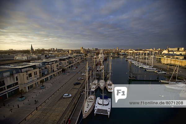 La Rochelle (17): View of the city from the Grand aquarium. Harbor and yachts  cloudy sky