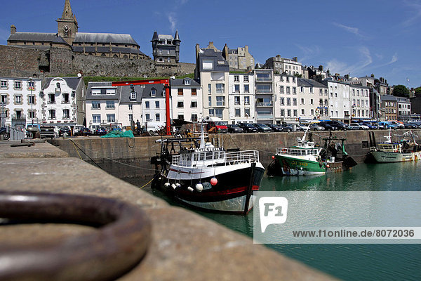 View of the waterfront along the harbour of Granville in the Manche department  Basse Normandie region (Lower Normandy). Fishing boat along the quayside and houses in the harbour
