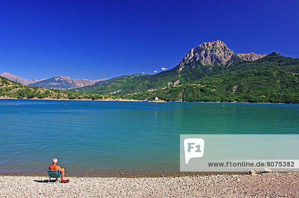 Feuerwehr  sitzend  Stuhl  Urlaub  Strand  See  Alpen  1  Leinwand