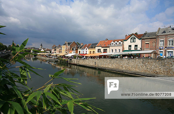 Quay in the district of Saint Leu in Amiens with numerous terraces of cafes and restaurants  on the banks of the Somme river. 2007/08/30