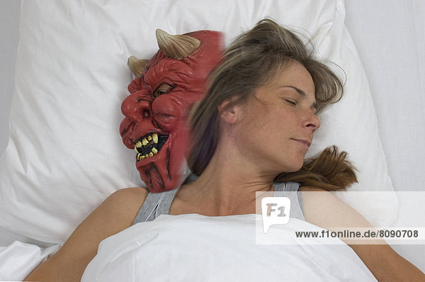 Sleeping woman and devil