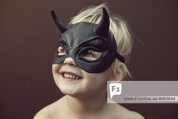 Caucasian boy wearing mask