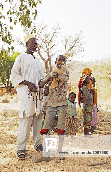 Doro  73  chief of the homestead  with his grandchildren and a monkey