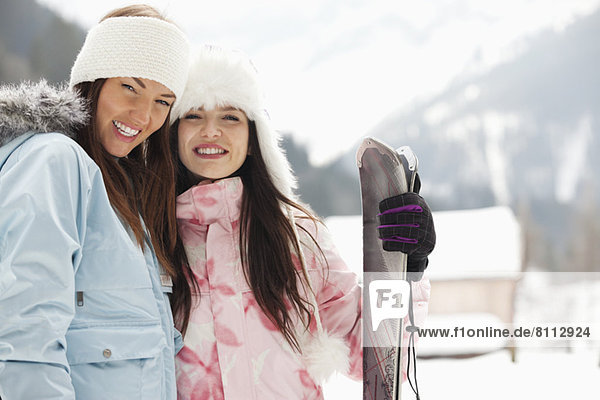 Portrait of smiling women with skis