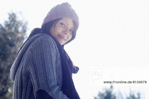 Portrait of young female wearing knitted hat