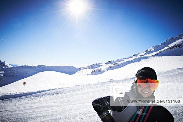 Woman wearing skiwear at top of mountain