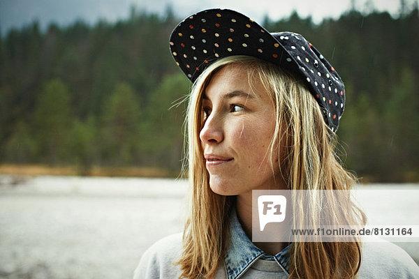 Portrait of woman wearing cap headwear