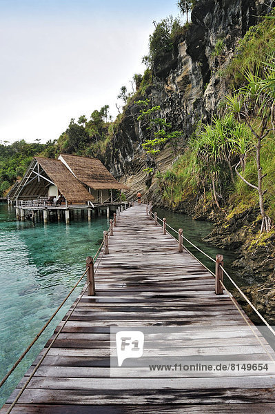 Wooden pier and water bungalows in a holiday resort