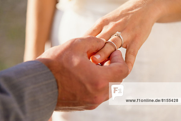 USA  Texas  Groom inserting ring to bride  close up
