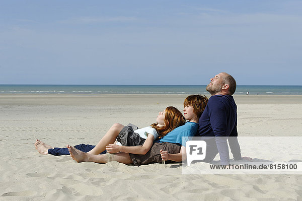 France  Father with son and daugher at beach