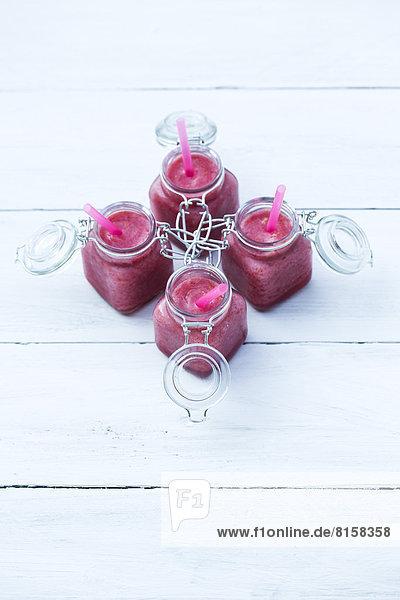 Raspberry smoothie in jar  close up
