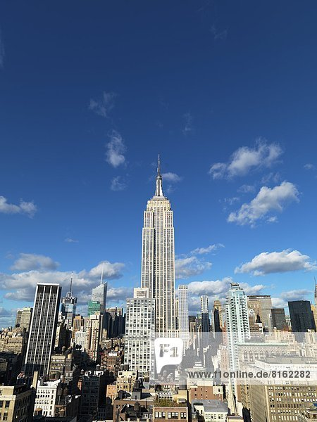 View of skyscraper with Empire State Building in New York City