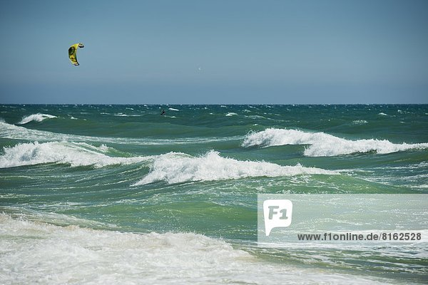 Mid adult man kite surfing