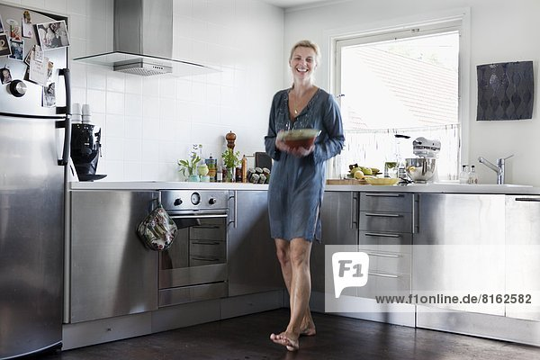 Smiling mature woman in kitchen