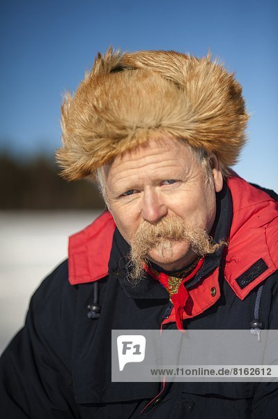Portrait of mature man wearing fur hat