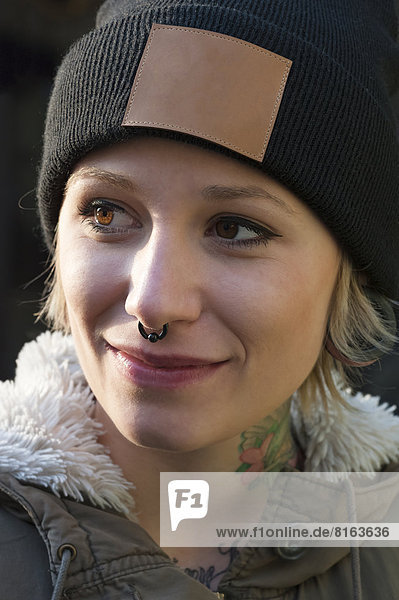 Germany  Young woman with nose ring  close up