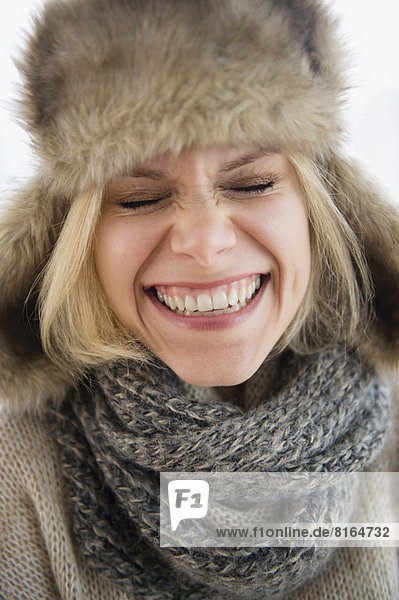Portrait of smiling woman in fur hat