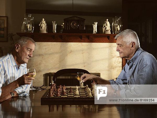 Two senior men enjoying a game of chess